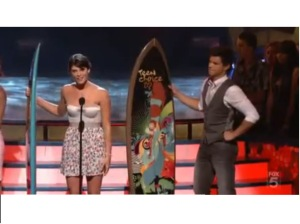 Taylor Lautner and Ashley Greene receiving their surfboards